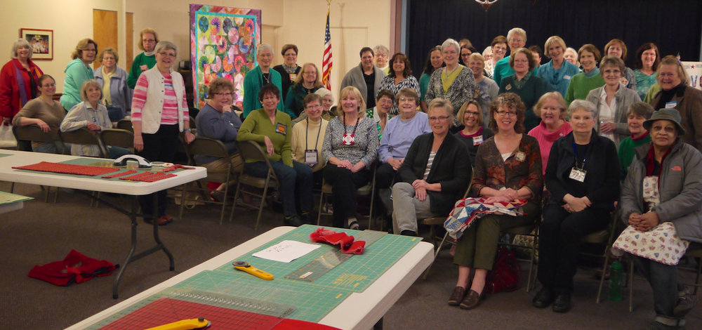 March Madness 2015; the guild is ready to work at the first special Quilts of Valor meeting. A fun time was had by all!