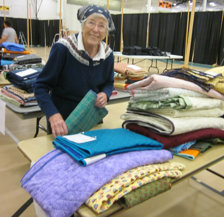 Mary Q. sorting quilts after check in.
