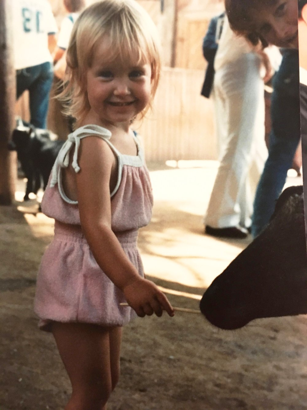 Back from india and off to the petting zoo; my big brother David looking on, Colorado 1980.