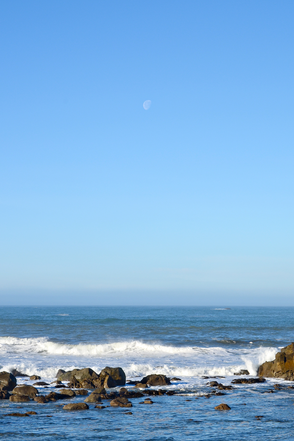 The moon setting over the Pacific along Highway 101 in Del Norte County.