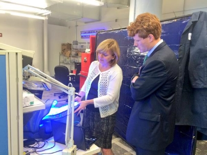 Donna Brezinski demonstrating the bili-hut™ to Congressman Joe Kennedy III, at MassChallenge