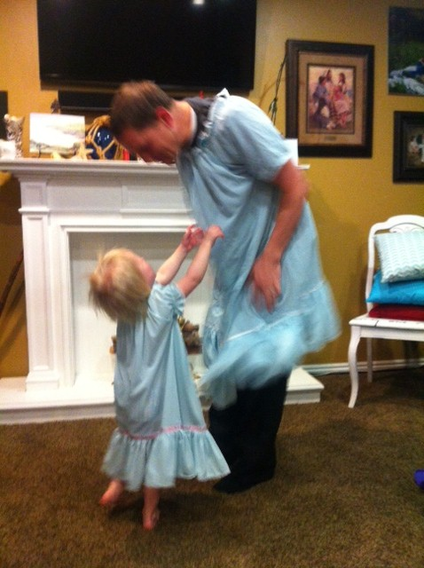 Skye twirling with her father in matching jammies, perfect for twirling!