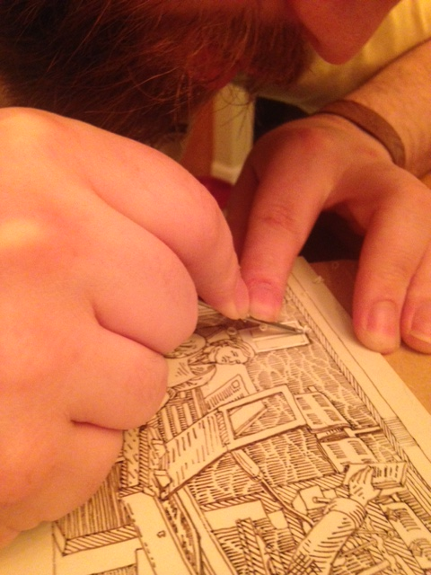 Process shot - Joseph carving his printing block.