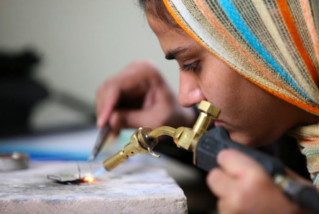 A student makes jewelry at the Institute of Afghan Arts and Architecture. Photo Credit: Turquoise Mountain Trust