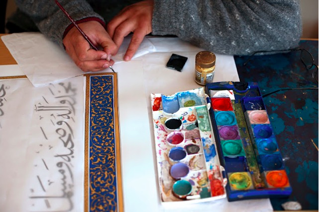 A student works on an illuminated manuscript at the Institute of Afghan Arts and Architecture. Photo Credit: Turquoise Mountain Trust: Turquoise Mountain Trust