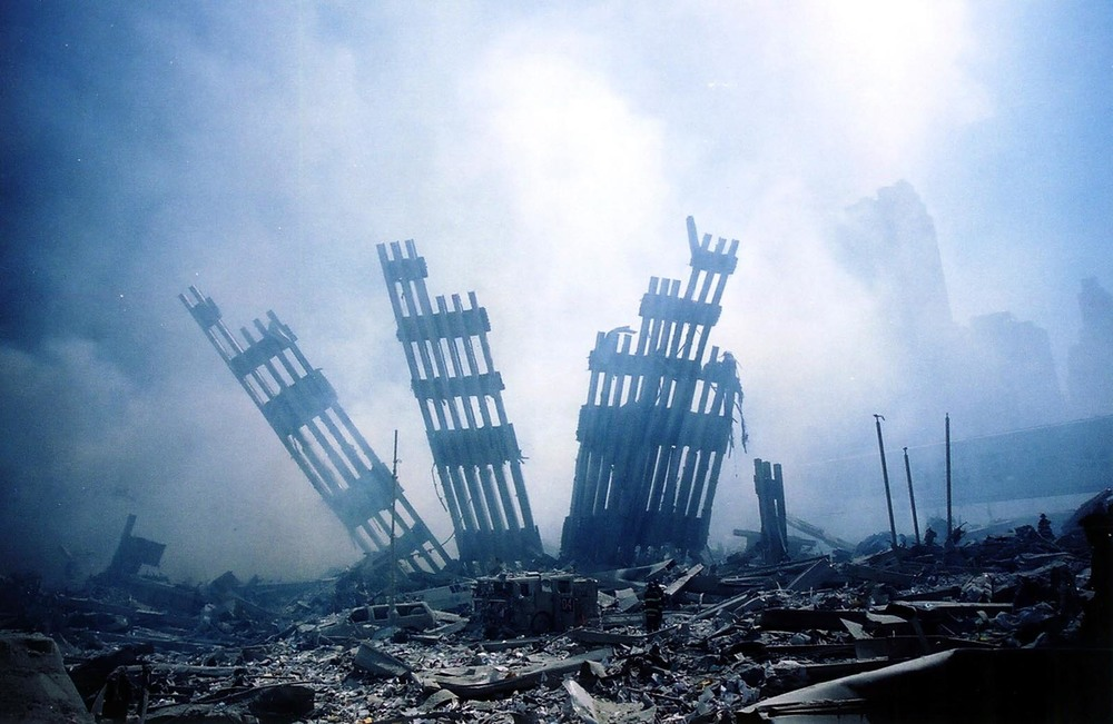 the-rubble-of-the-world-trade-centre-smoulders-on-september-11-data.jpg