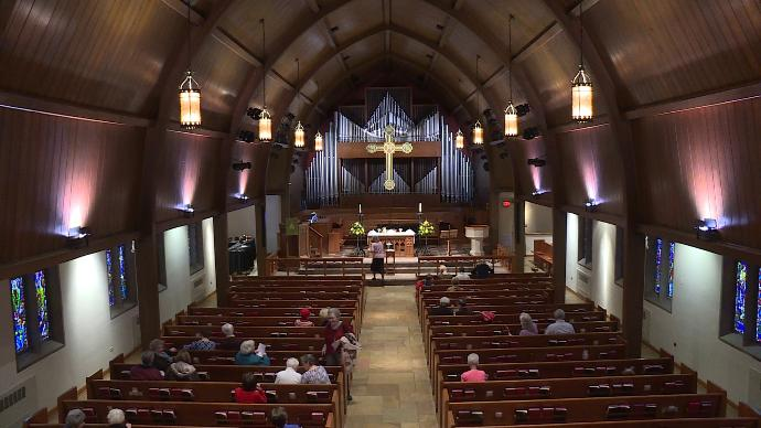 WVLT filmed a story at First Church about how not to spread the flu in church.