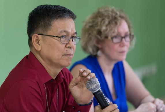 Bishop Ciriaco Q. Francisco (left) presides over a meeting of the United Methodist Committee on Central Conference Matters in Abidjan, Côte d'Ivoire. At right is the Rev. Deanna Stickley-Miner
