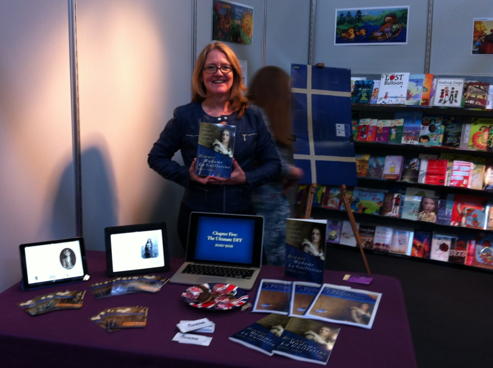 Speaking to fellow SCBWI authors at the SCBWI stand of the Bologna Children's Book Fair.
