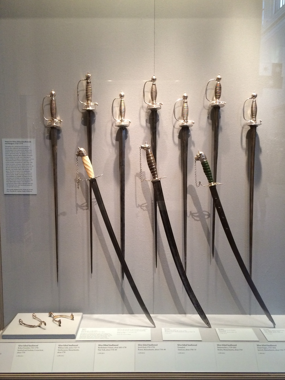 Paul Revere's spurs, three hangers, and seven smallswords, all dating to 18th century colonial America.