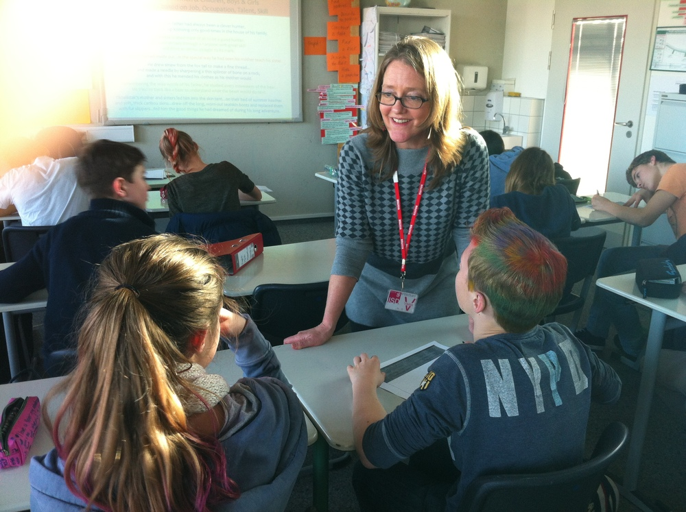 Sarah conferring with two ISD 7th graders, Feb 2014 (it was crazy hair day).