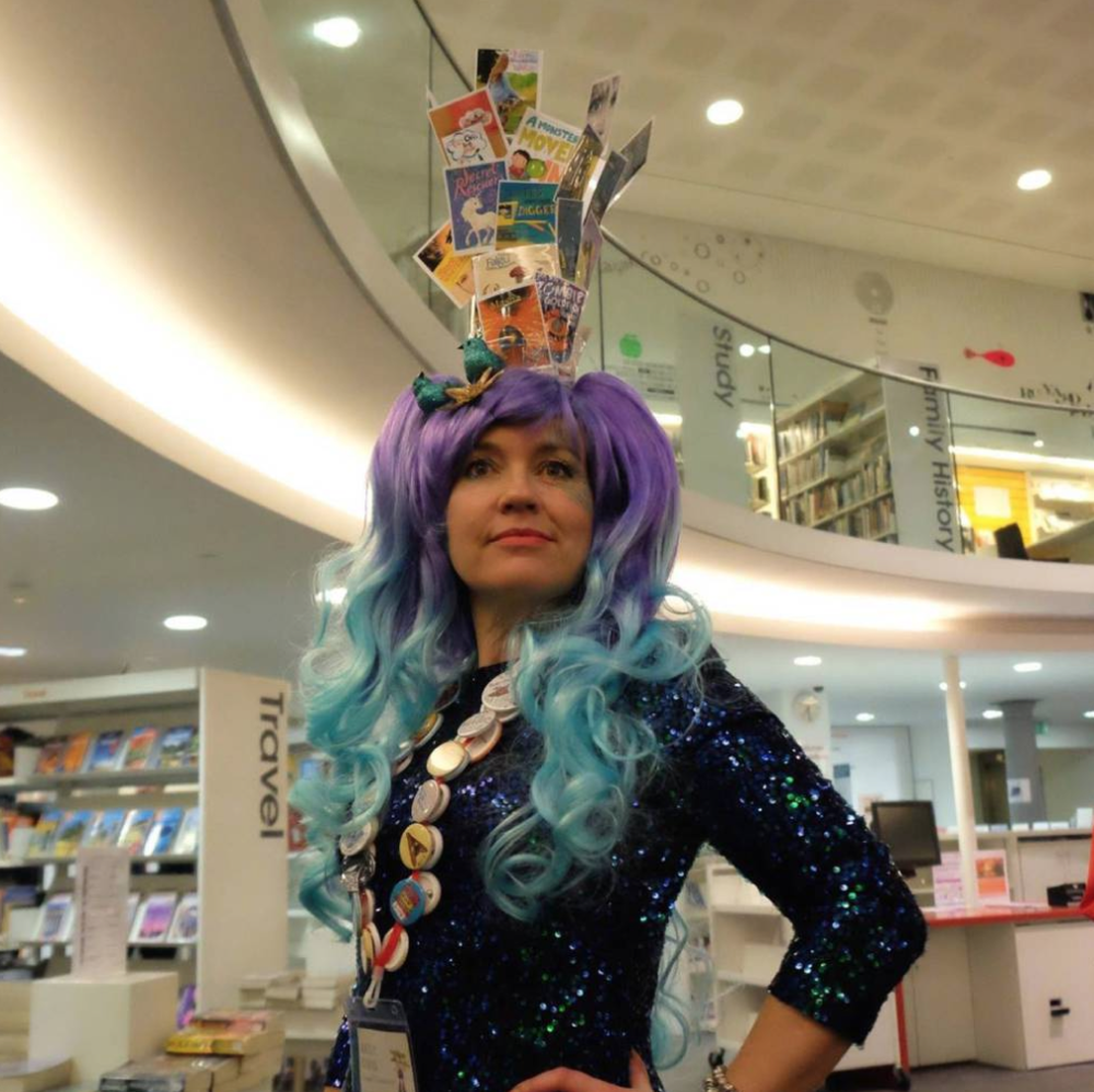 Kathryn Evans models her Sea Wig made of book covers by this year's SCBWI-BI launch authors.