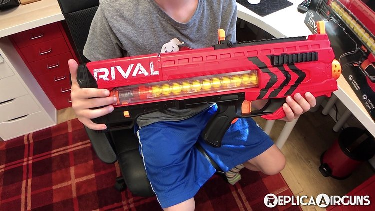 Type: Nerf Gun. Manufacturer: Nerf Hasbro Model: Rival Zeus MXV-1200.  Materials: Mostly plastic build. Weight: About 3 pounds with batteries  installed.
