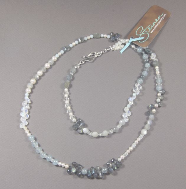 "Custom 33"" necklace made with pearls, blue calcite, amazonite, labradorite, grey moonstone, rainbow moonstone, clear quartz, cat's eye, aquamarine, and a sterling silver clasp."