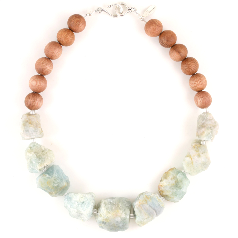 Our Daylily necklace is made with large, rough aquamarine nuggets and rosewood