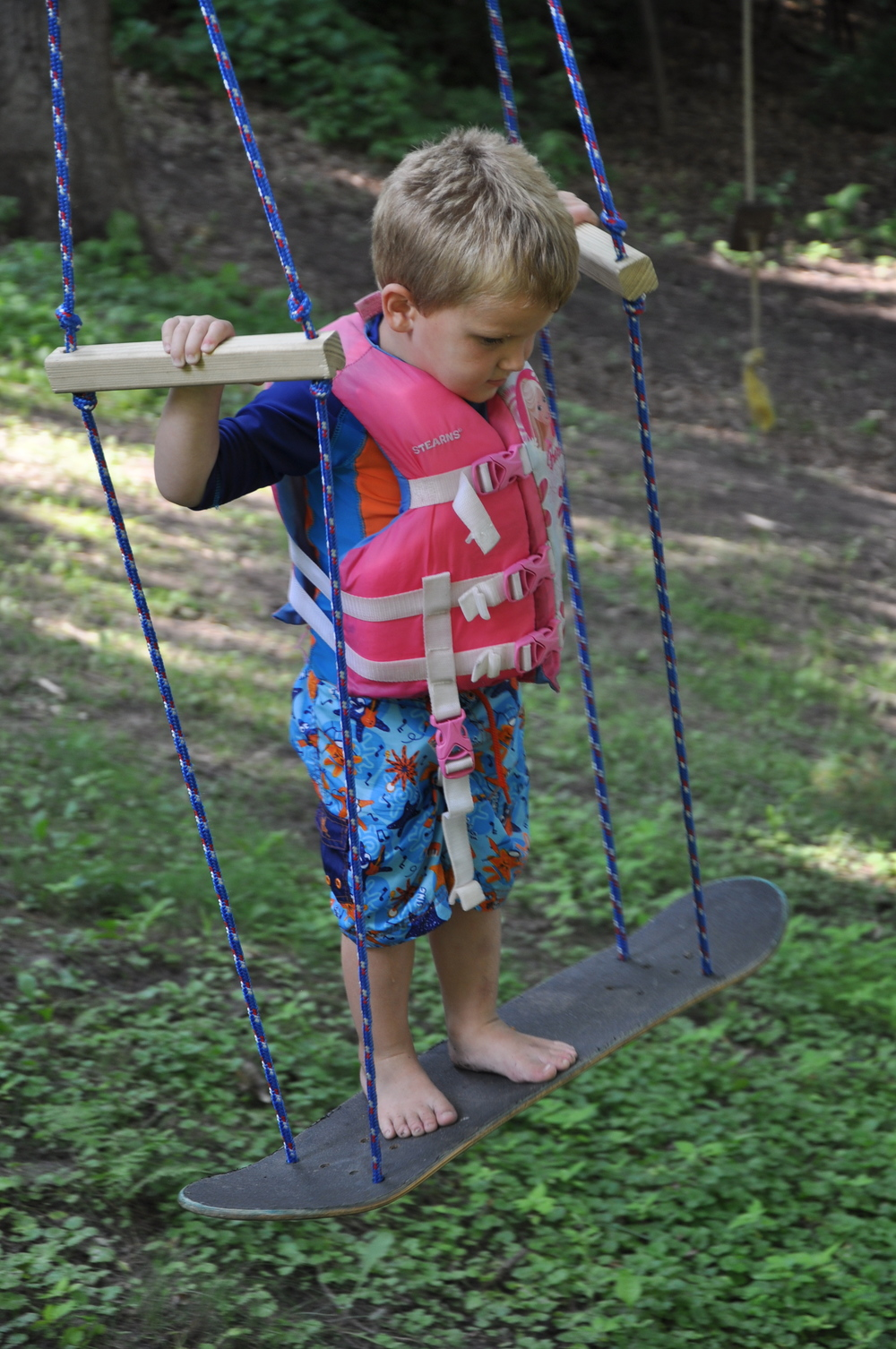 OK I know someone will ask why Johnnie has a lifejacket on. He came from the pool to try the new swing.