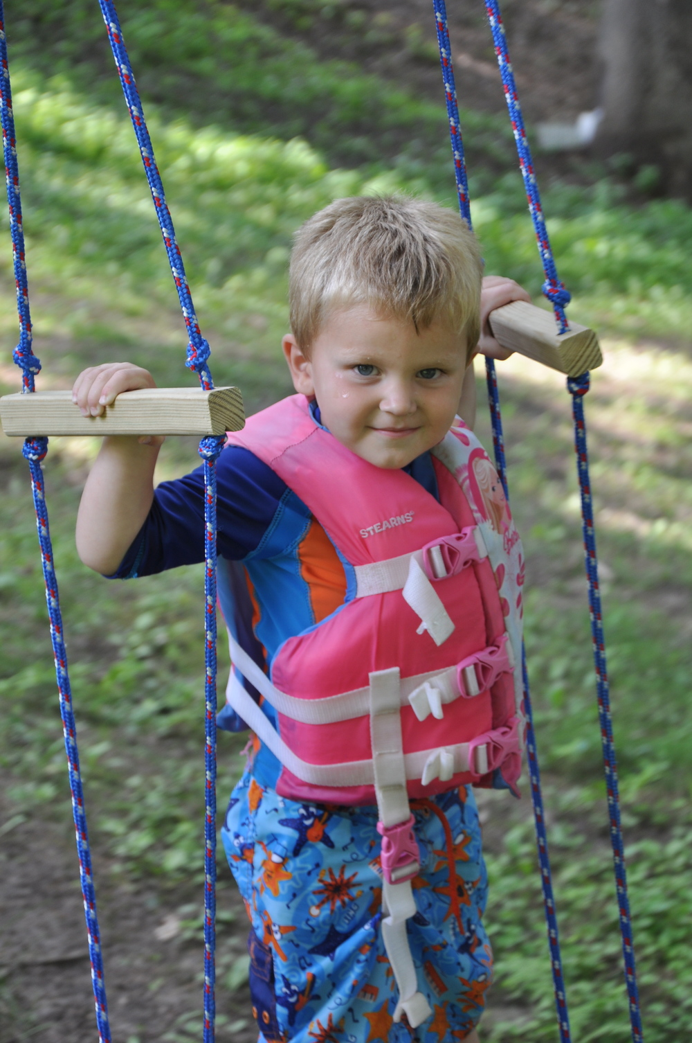 We hung the swing in a rather large tree and spaced the handles for older kids. Johnnie age 3 had little trouble get the hang of the skateboard swing.