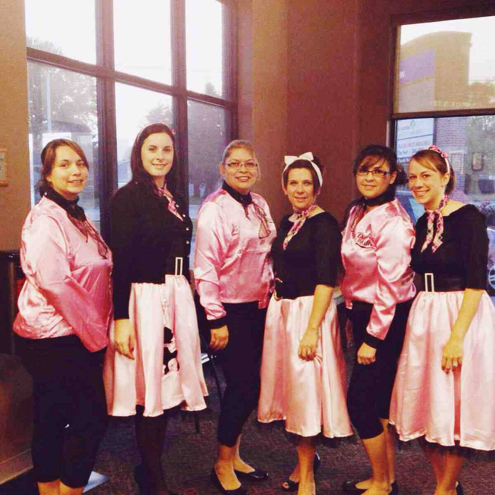 Our Grand Island Branch dressed up as the Pink Ladies! Laura, Jennifer, Natalia, Denise, Karina, & Morganne