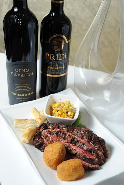 Kinize Chophouse Steak 25 Years Anniversary Steakhouse Ribeye Cap Steak Entree with Beef Bombas and Mango and Pineapple Salsa with Cinq Cepages and Pride Mountain Wine.jpg