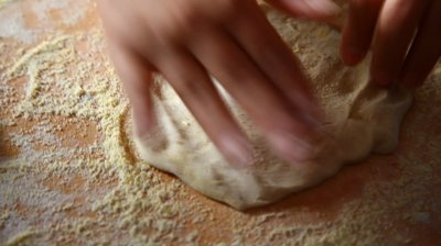 stock-footage-kneading-dough-for-pita-bread-on-wooden-board.jpg