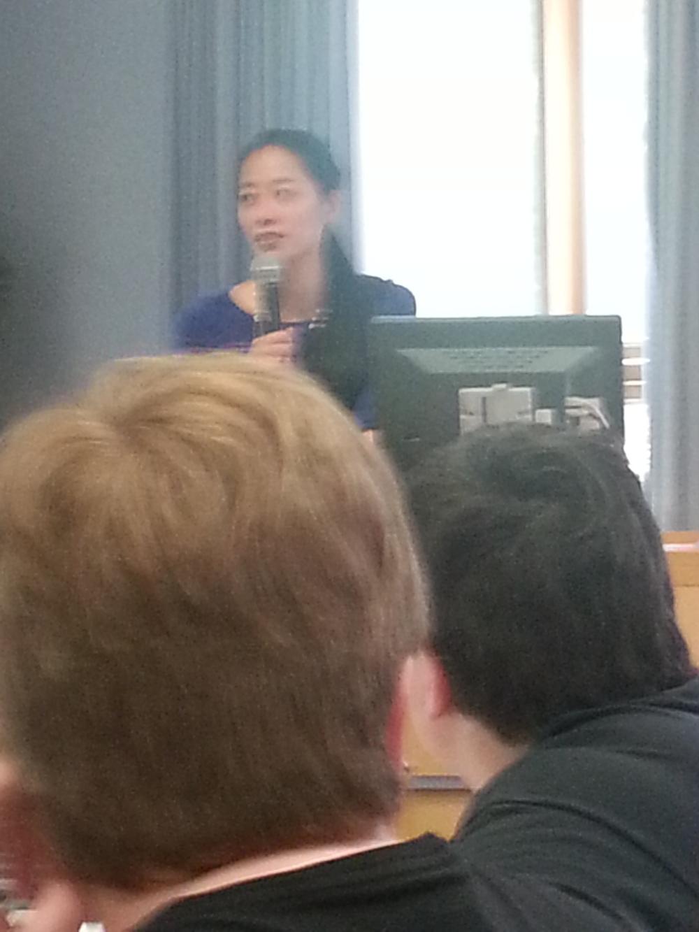 Adeline Koh giving an award.
