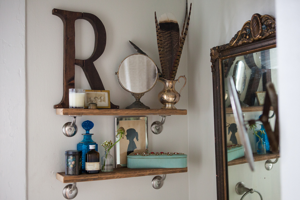4.   Even your restroom can be a place to display pieces which are special to you.     The restroom can be beautiful and functional. I try to decorate with pieces that have a story and mean something to me. Every item on these shelves tells a story. The R was a house warming gift from my precious friend, James, of   Handy Andy Productions . Since I love giving and receiving personalized gifts, this letter meant so much to me. I love my wooden initial!  James finished it off with copper nails because he knows how much I like copper!