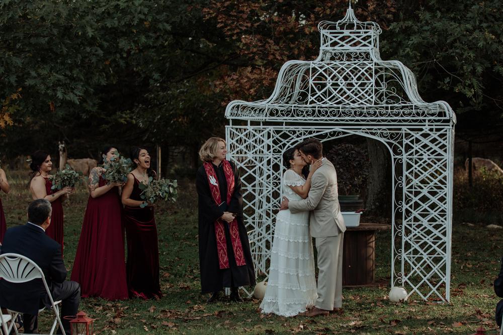 woods-edge-wools-alpaca-farm-wedding-photography-ceremony-first-kiss