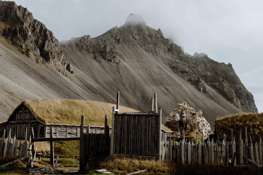 Looks like a location right out of  Game of Thrones!  This is the remains of a viking movie set with the mountain Vetrahorn in the background as seen on our    Traveling Iceland Day 7 post.