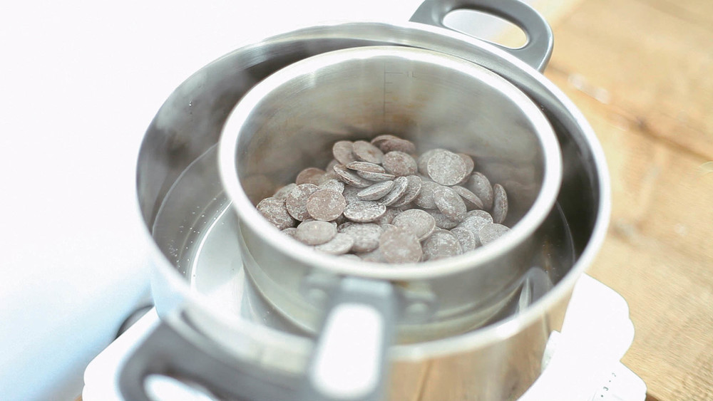 1. Melt Chocolate in a double boiler. Start by bringing a few inches of water to a boil and then once it reaches boiling point, turn to low and sit chocolate in the water and let it slowly melt, stirring often.