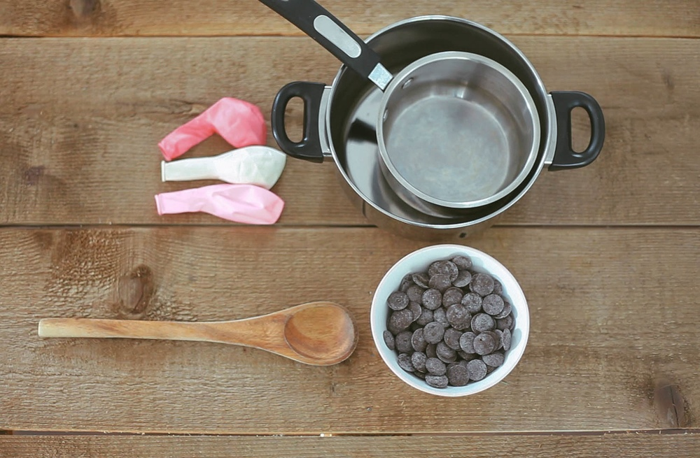Supplies you will need: - Small balloons, melting chocolate, a double boiler, spoon for stirring, water.