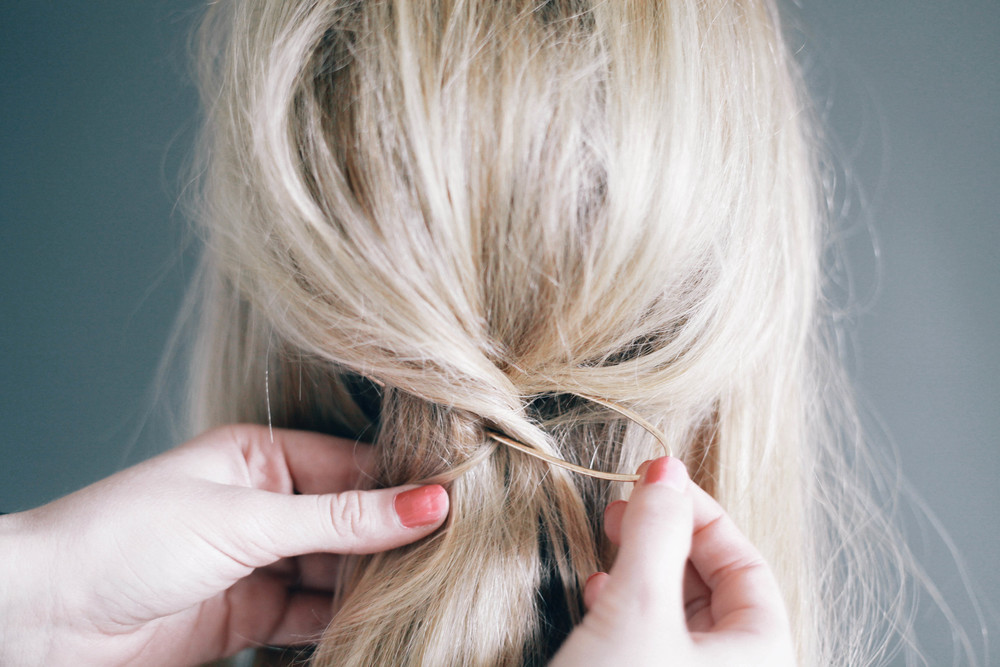 http://treasuresandtravelsblog.com/blog/2015/7/6/half-up-hair-tutorial-treasures-hair-pin