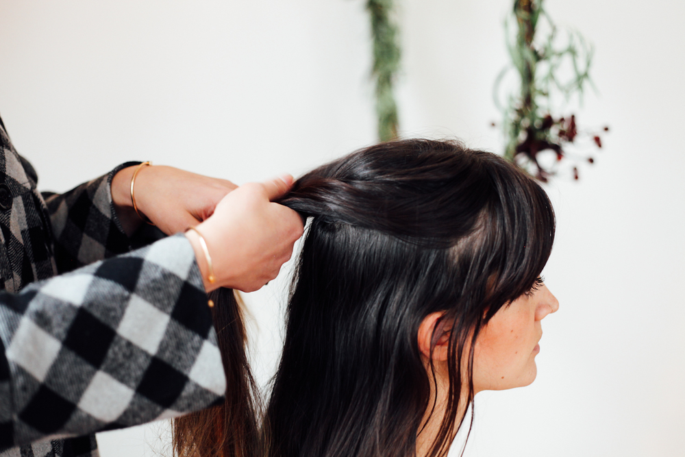 Starting at the crown of your head grab two pieces. Take one small piece from the left and add it to the right. Take a small piece from the right and add it to the left. And because you're french braiding as well, grab pieces to add to the braid as you go.