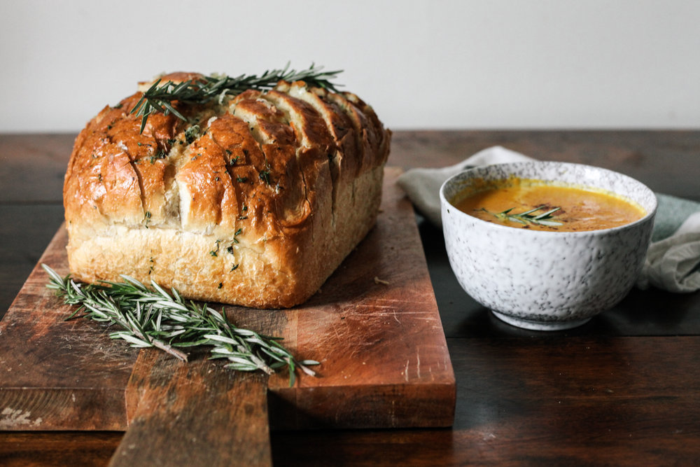 http://treasuresandtravelsblog.com/blog/2016/2/6/cheesy-garlic-herb-sourdough-bread