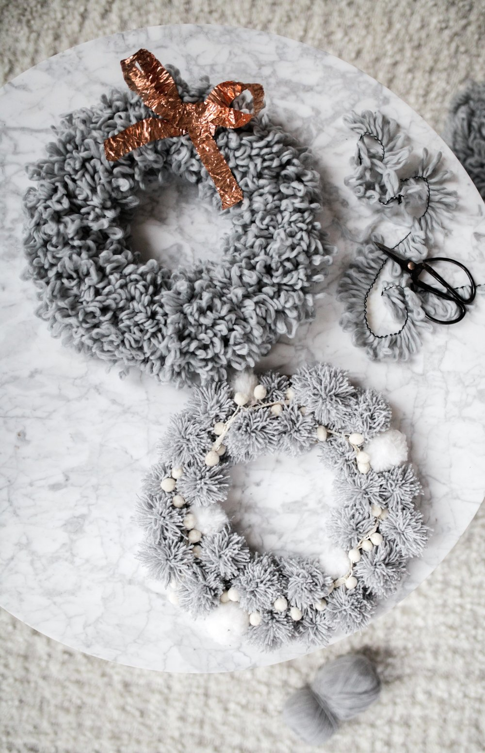 diy pom pom wreath holiday yarn.jpeg