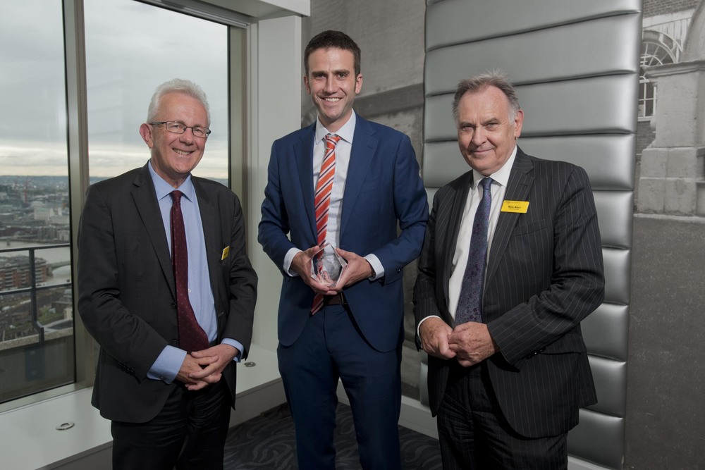 Daniel Tweedie with Sir Hugh Taylor and Sir Ron Kerr receiving a Trust CARE award for outstanding patient care.
