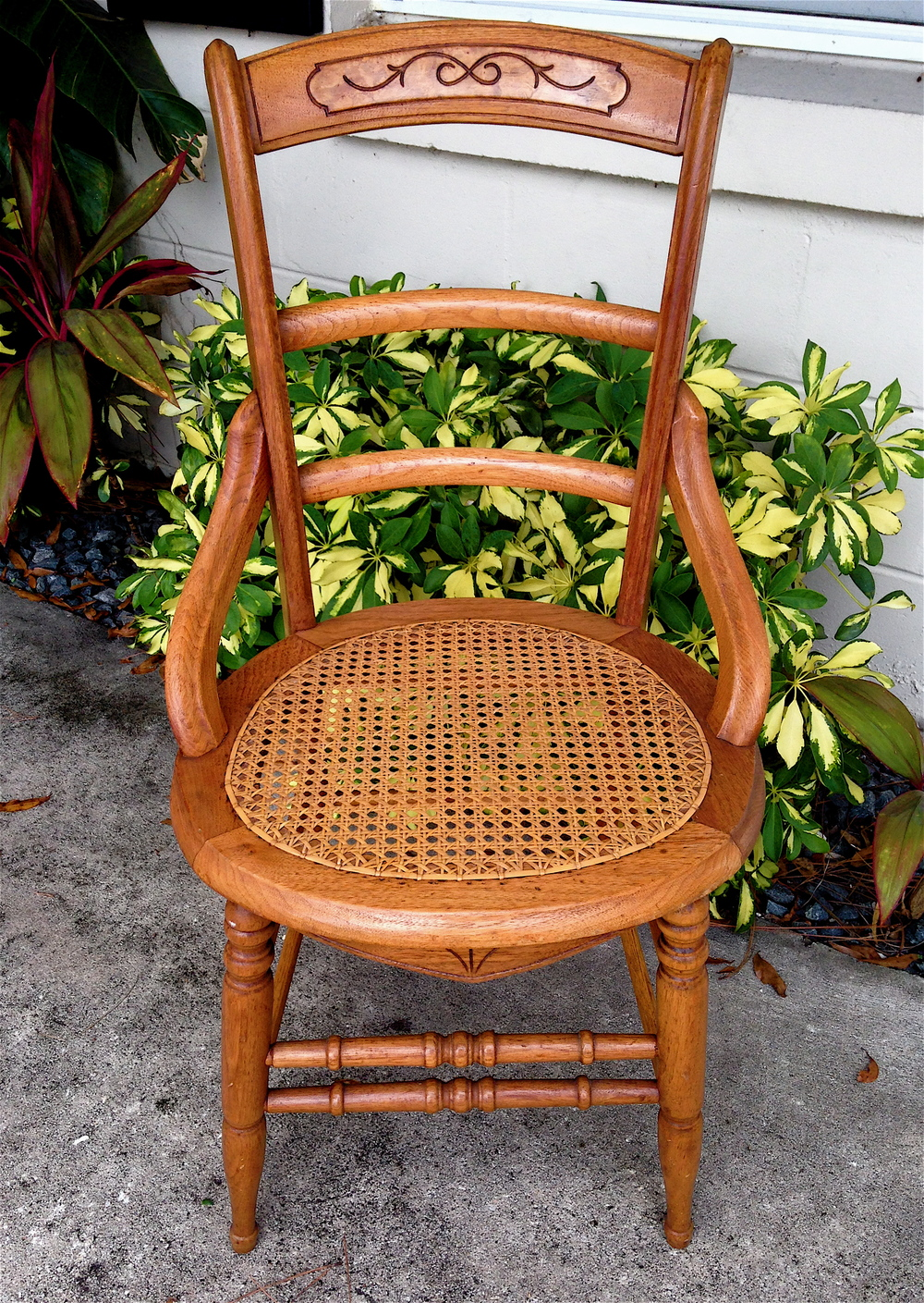 Victorian chair, cane seat, hip rests