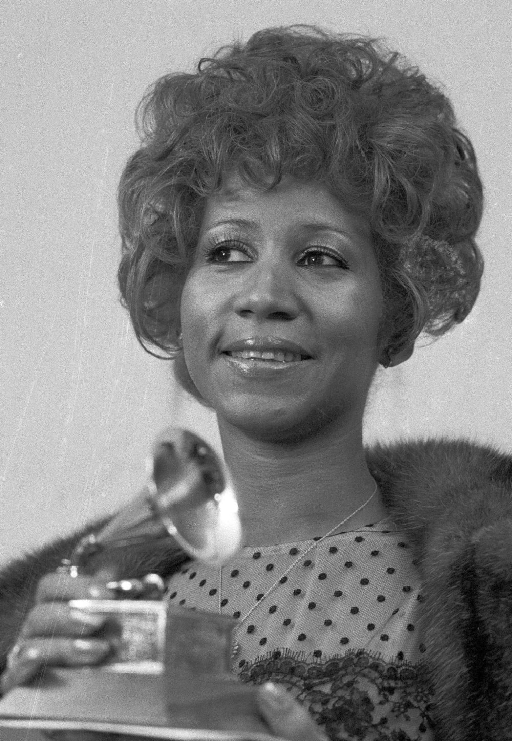 "Grammys (1972) Aretha Franklin holds her Grammy Award trophy for Best Rhythm and Blues performance of the song ""Bridge Over Troubled Waters.""   AP PHOTO/DAVE PICKOFF"