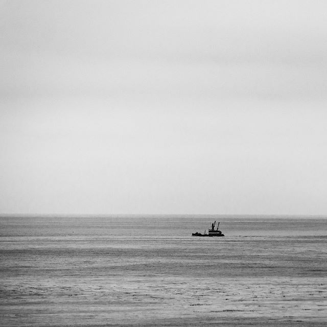 The lonely fishing boat. #fishing #ocean #panoramic #pacificbeach #blackandwhite #boat #alone #peacful #nikonusa #sigmaphoto #landscape #oceanscape #raymondvestalphotography