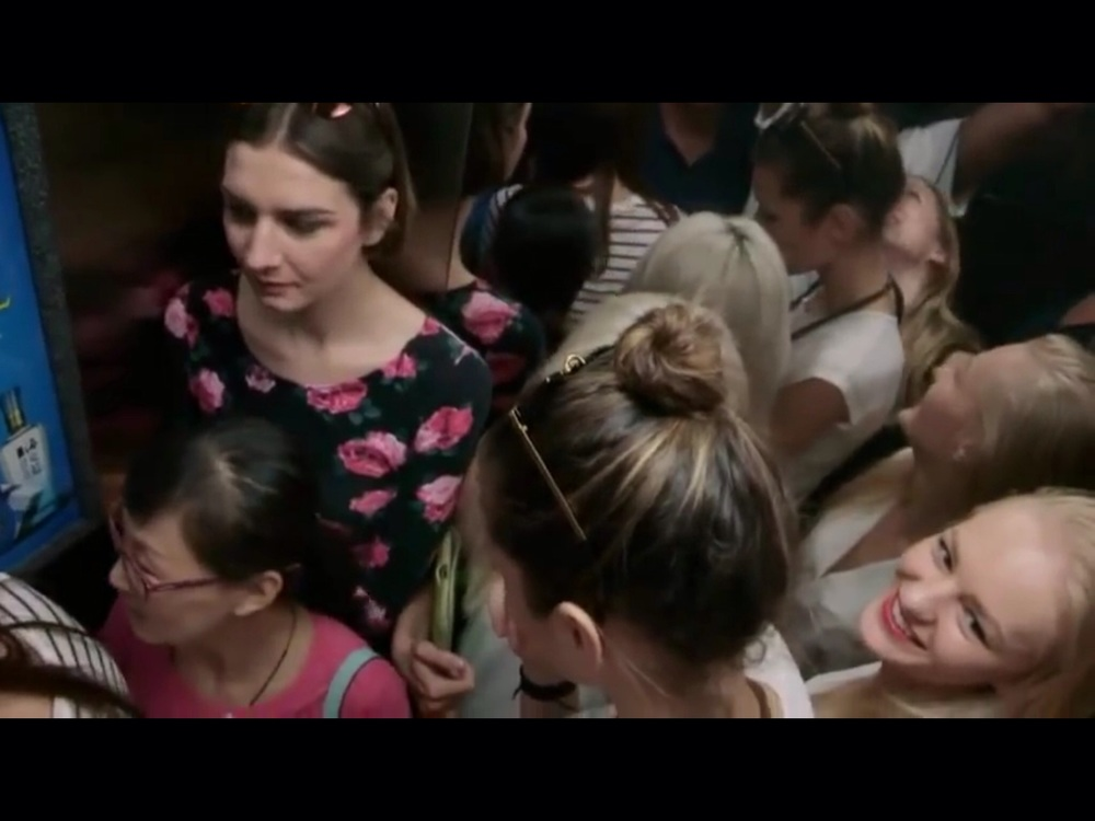 Models cramped in an elevator on the way to a casting | Still from  Siberian Supermodels