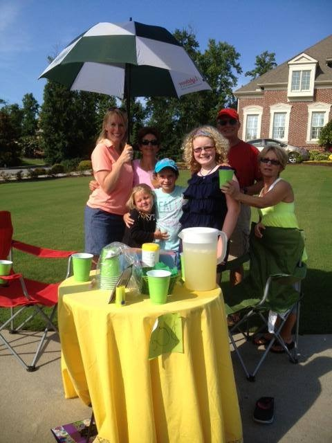 A family hosting a LemonAide stand to raise funds to fight CP!