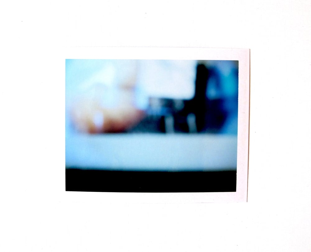 Instant photographs (double and triple exposed) of Macbook screenshots from the short film— The Iapetus Sea —taken with a 1968 Polaroid Land Camera / 2015