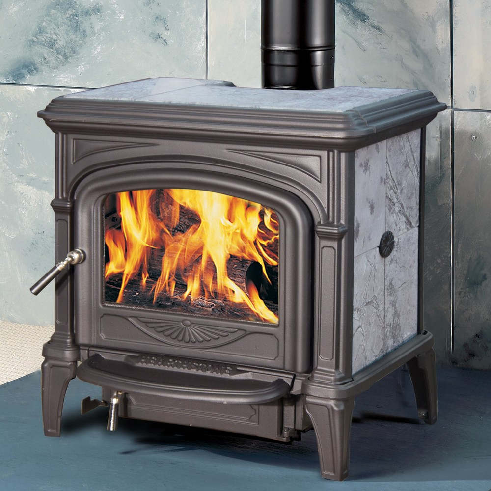 Hearthstone Phoenix wood burning stove has been a popular choice for many years.  The stove features more cast iron on the front and back and a 45 deg. angle flue collar for top or rear venting. Middle powered. Made in USA