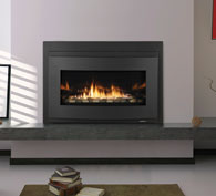 Transform an existing fireplace opening. A reflective black glass interior and a long ribbon of flame deliver unmatched style.