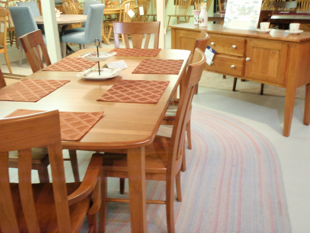One of our favorites... solid cherry, Tulip style chairs, saber leg table...  shown with matching sideboard!