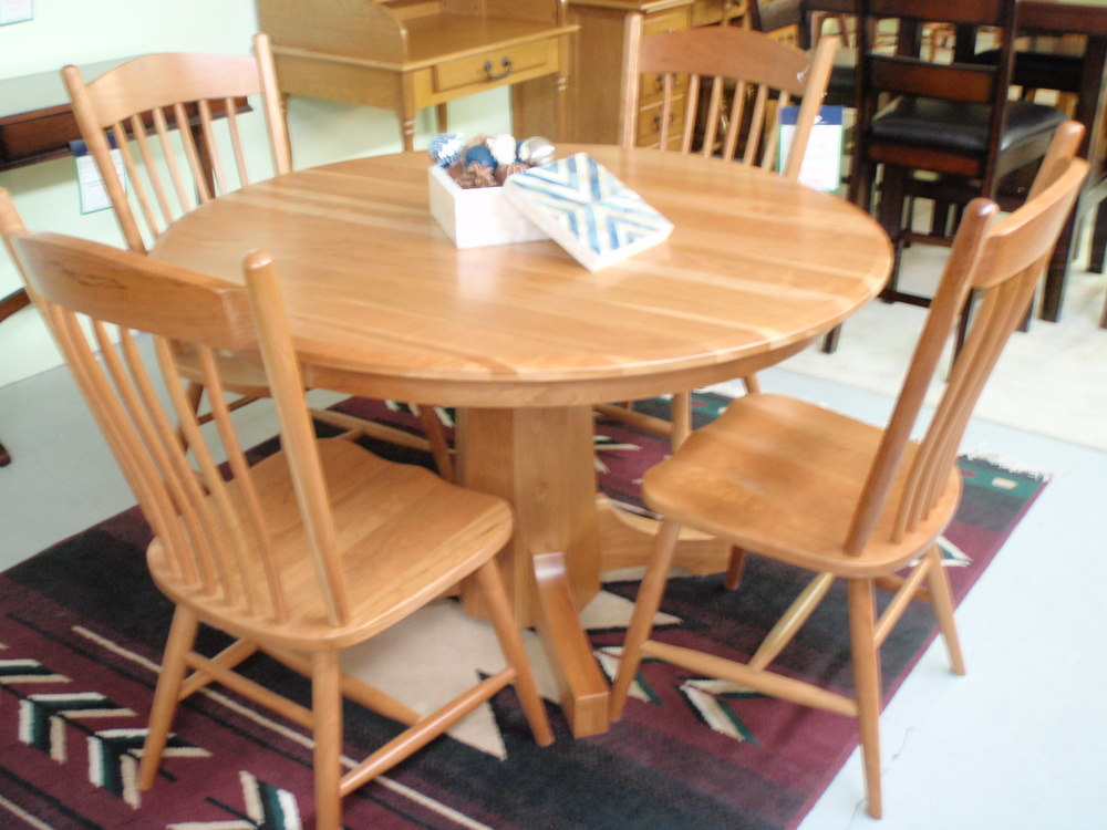 Absolutely the finest finish quality and feel!  This cherry pedestal table has beautiful grain that shines through the silky smooth catalyzed finish.
