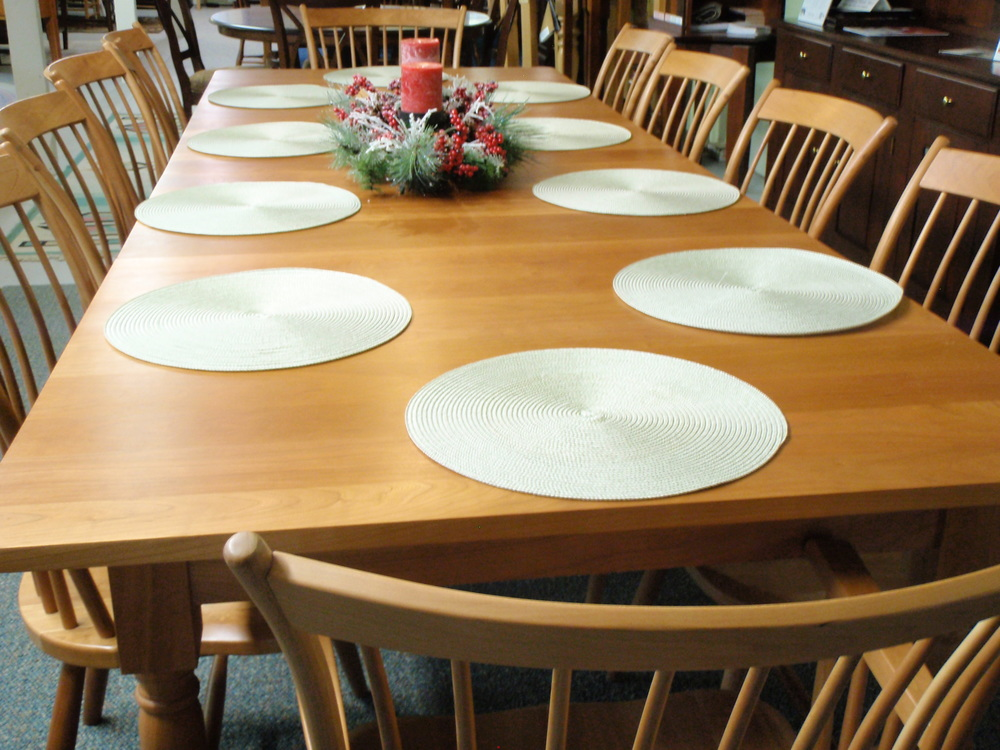 One of our favorite tables of all time...  Gat Creek's solid natural cherry Farmer's Table with four (4) leaves, and solid cherry Wellesley chairs!  Multiple finish and stain options are available as well as table edge, leg selection, number of leaves and extension configuration, and chair choices.