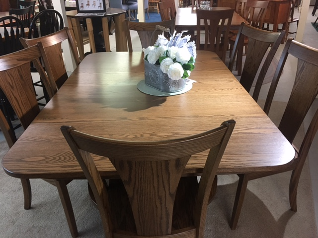 Stylish and oh so comfortable solid OAK! Set shown includes two leaves.