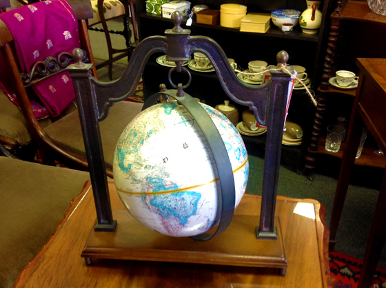 Globe hanging on metal frame