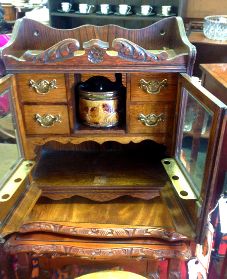 Oak smokers cabinet with Doulton lidded jar