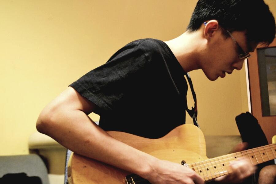 Chun Kit, Guitarist.